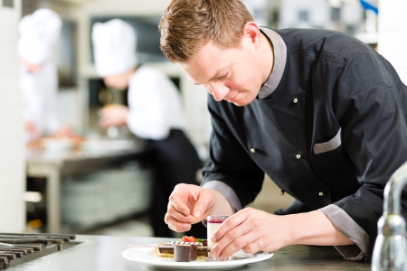 pastry: Cook, the pastry chef, in hotel or restaurant kitchen cooking, he is finishing a sweet dessert