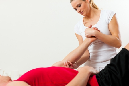 Patient at the physiotherapy doing physical therapy exercises with his therapist Stock Photo - 17263817