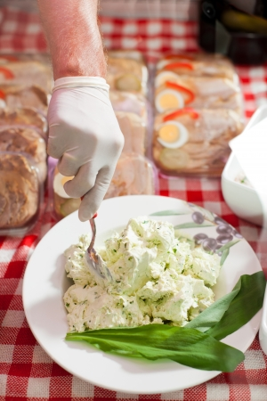 viands: Working in a butchers shop with cream cheese
