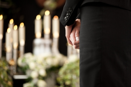 Religion, death and dolor  - woman at urn funeral mourning the death of a loved person Stock Photo