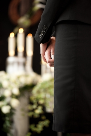 funeral parlor: Religion, death and dolor  - woman at urn funeral mourning the death of a loved person Stock Photo