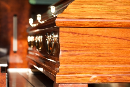 dolor: Dolor - Funeral with coffin on a cemetery in hearse