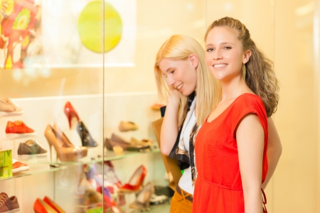 Friends shoe shopping in a mall or shop having fun Stock Photo - 17324658