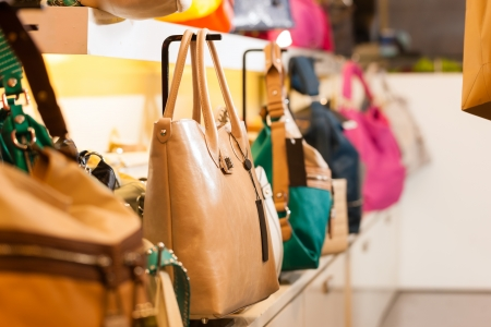 retail display: Leather bags in a shop waiting for customers Stock Photo