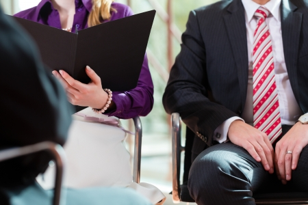 candidate: Man having an interview with manager and partner employment job candidate hiring resume CEO work business closeup cutout Stock Photo