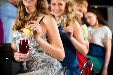 Young people in club or bar drinking cocktails and having fun Stock Photo - 17324886