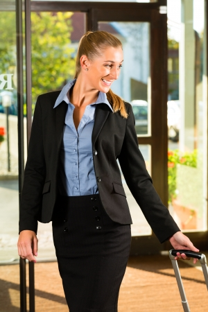 Businesswoman arriving at Hotel with her suitcases Stock Photo - 17324744