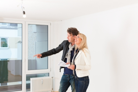 apartment market: Real estate market - young couple looking for real estate to rent or buy an apartment