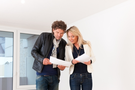 apartment market: Real estate market - young couple looking for real estate to rent or buy an apartment  Stock Photo