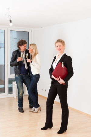 Real estate market - young couple looking for real estate to rent or buy an apartment Stock Photo - 17424857
