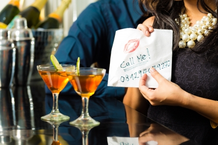 foxy girls: Asian woman seduces the man in restaurant and gives him her number on a napkin