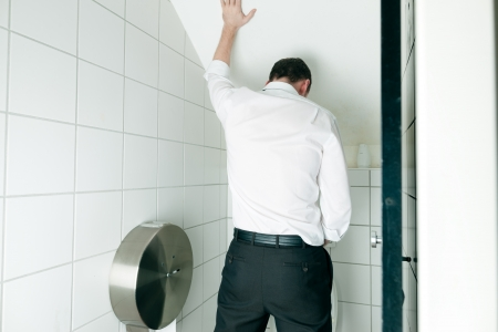 Man peeing in toilet photo