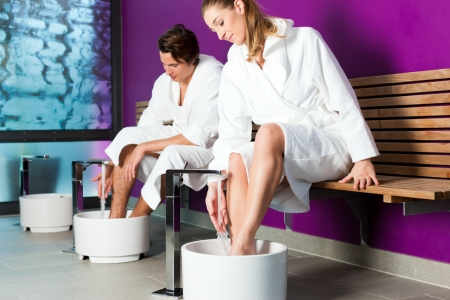 hydrotherapy: Couple - man and woman - having hydrotherapy water footbath in spa setting