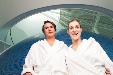 Young couple in bathrobe in Spa, they standing under a dome Stock Photo - 17424818