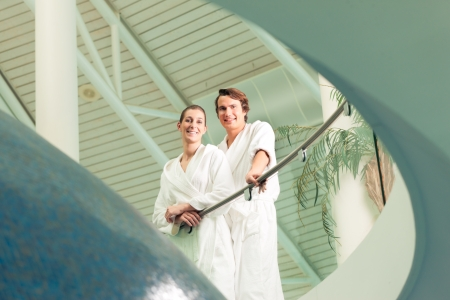 Young couple in bathrobe in Spa, they standing under a dome Stock Photo - 17424825