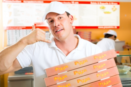 takeaway: Man holding several pizza boxes in hand and asking you to order pizza for delivery