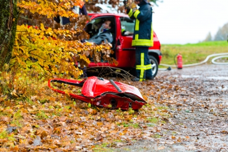 Accident - Fire brigade rescues accident Victim of a car, a car door lying on the slippery pavement Stock Photo - 17657360