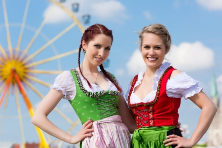 Young women in traditional Bavarian clothes - dirndl or tracht - on a festival or Oktoberfest photo