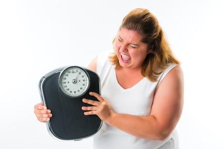 donne obese: donna obesa cerca incazzati o arrabbiato con scala Archivio Fotografico