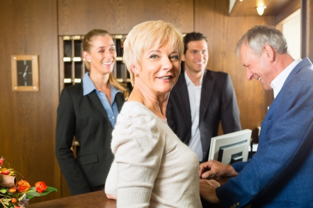 hotel service: Reception - Guests check in at hotel and getting information
