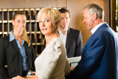 desk clerk: Reception - Guests check in at hotel and getting information