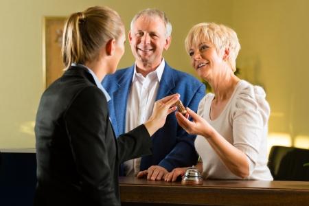 vacancier: Accueil - Les clients doivent s'enregistrer � l'h�tel et obtenir la cl�