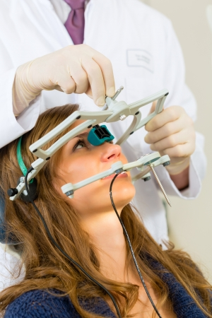 dental practice: Female patient with dentist in a dental treatment, wearing gloves Stock Photo