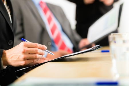 present presentation: Business - businesspeople have a meeting or workshop with presentation in office, they negotiate or sign a contract Stock Photo