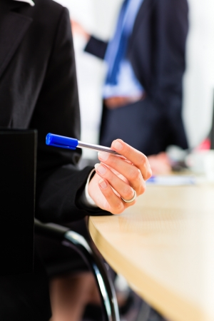 Business - businesspeople have a meeting with presentation in office, they negotiate a contract - closeup Stock Photo - 17657370