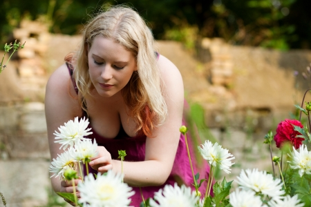 Woman doing garden work in the chrysanthemums on a beautiful summer day Stock Photo - 17743362