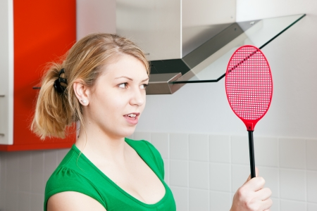 gnat: Woman screaming being afraid of spiders or insects in her apartment Stock Photo