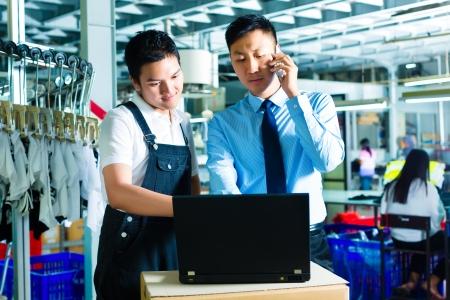 quality controller: Worker or production manager and customer service, look on a laptop in a textile factory and help on the phone