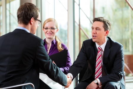 job recruitment: Man having an interview with manager and partner employment job candidate hiring resume CEO work business shaking hands Stock Photo