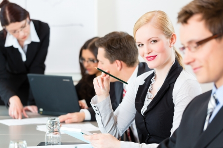 Business - businesspeople have a meeting or workshop with presentation in office photo