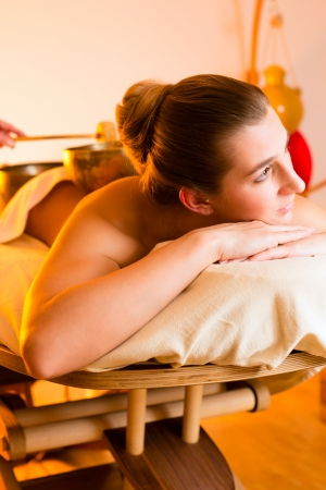 Woman in wellness and spa setting having a singing bowl massage therapy Stock Photo - 18182576