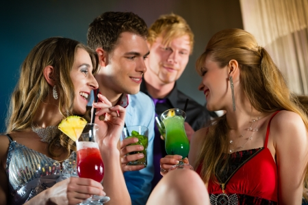luxury party: Young people in club or bar drinking cocktails and having fun Stock Photo