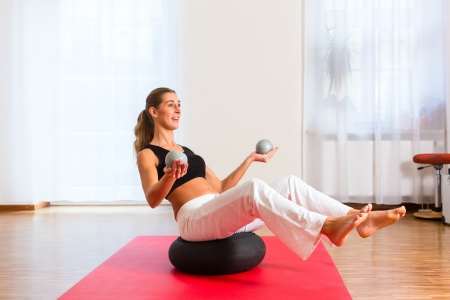 Patient uses a ball during the physiotherapy photo