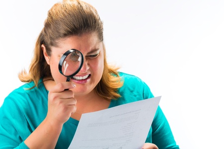 Woman looking through magnifying glass or loupe Stock Photo - 18231136