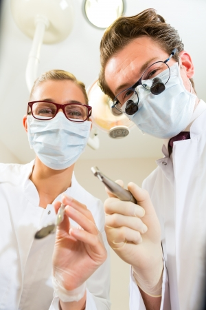 Dentist and assistant at a treatment, from the perspective of a patient Stock Photo - 18231091