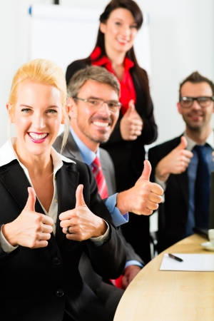 thumbs up business: Business - businesspeople have team meeting or workshop in an office, it is a very good team Stock Photo