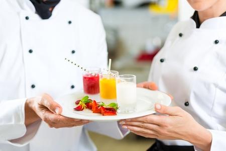 Chef team in restaurant kitchen with dessert working together Stock Photo - 18344895
