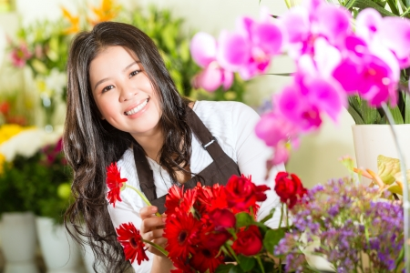 florist shop: Friendly Asian florist or Saleswoman in a flower shop
