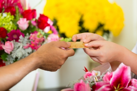 cashless: Cashless payments in a flower shop Stock Photo