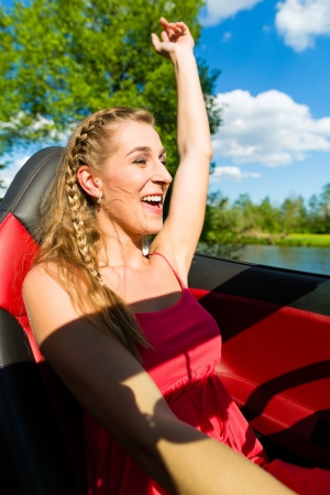 cabrio: Young beautiful woman  with cabriolet convertible car in summer on a day trip Stock Photo