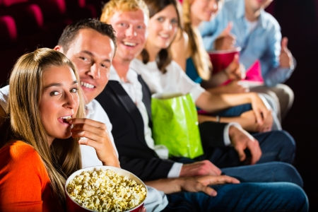 People see a movie in the cinema and have fun they smile at the camera Stock Photo - 18476313
