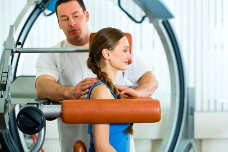 physical: Patient at the physiotherapy making physical exercises with her therapist Stock Photo