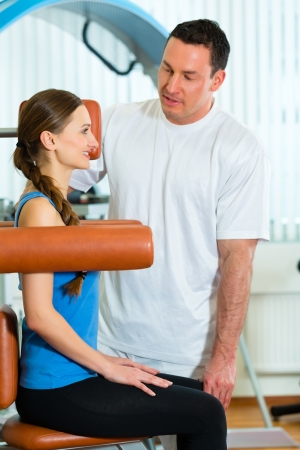 physical therapy: Patient at the physiotherapy making physical exercises with her therapist Stock Photo