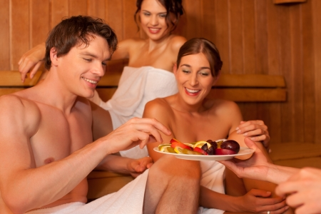 Four people or friends in sauna photo