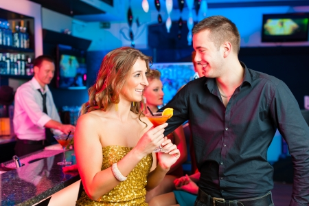 might: young couple in bar or club drinking cocktails, it might be the first date Stock Photo