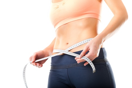 measure waist: Diet - young woman is measuring her waist with measuring tape Stock Photo